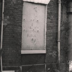 """""""Anarchy Doesn't Rule OK!""""; back of Havelock Square houses, May 1979 