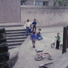Children and bikes, Broomhall Flats play area. July 1978 | Photo: Tony Allwright
