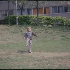 Boy kicking, Broomhall Flats. July 1978 | Photo: Tony Allwright