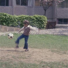 Boy kicking ball, Broomhall Flats. July 1978 | Photo: Tony Allwright