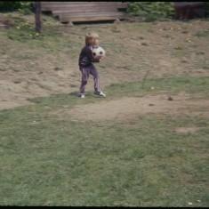 Boy holding ball, Broomhall Flats. July 1978 | Photo: Tony Allwright