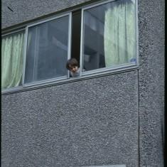 Peeking out the window. Egerton Gardens, Broomhall Flats. July 1978 | Photo: Tony Allwright
