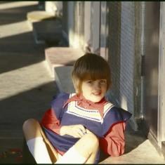 Girl on doorstep, Broomhall Flats. July 1978 | Photo: Tony Allwright