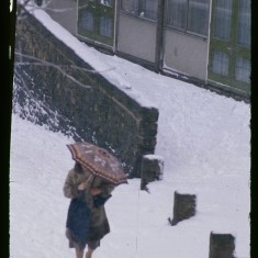 Pedestrian in the snow, Broomhall Flats. March 1979 | Photo: Tony Allwright