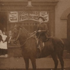 James William Cooper (aged 9) outside Cooper's Fruit & Veg shop, 135 Broomhall St, c.1905 | Photo: Edward Bell