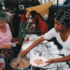 Woman serving food at the Carnival | Broomhall Centre archive