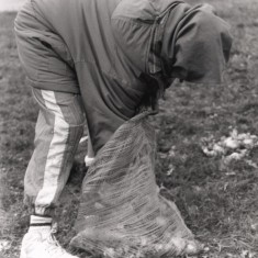 Young person gathering garden waste. 1992 | Photo: Broomhall Centre