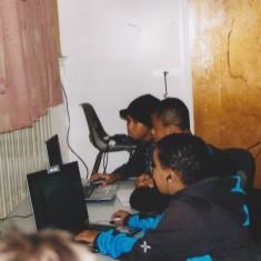Children working on computers at Homework Club. 2007 | Photo: Polly Blacker / Tony Cornah
