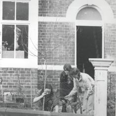 Tony, Cath, Polly and Anna tree planting in the Rabbit House Garden. 1980 | Photo: Polly Blacker / Tony Cornah