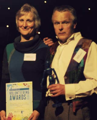 Polly and Tony receiving their Volunteering Award, 2013