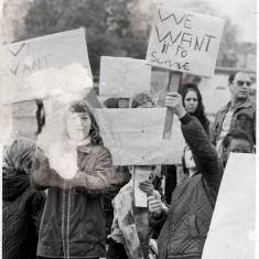 """Children holding a banners """"We want to Survive."""" 1980s 