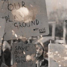 """Children holding a banners """"Save our playground. Or else."""" 1980s 