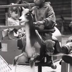 Child on fairground ride. 1992   Photo: Broomhall Centre